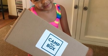 cute 7 year old girl holding box